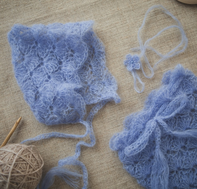Crochet warm blue clothes for a baby