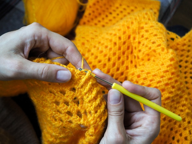 Crochet. woman crochet yellow yarn