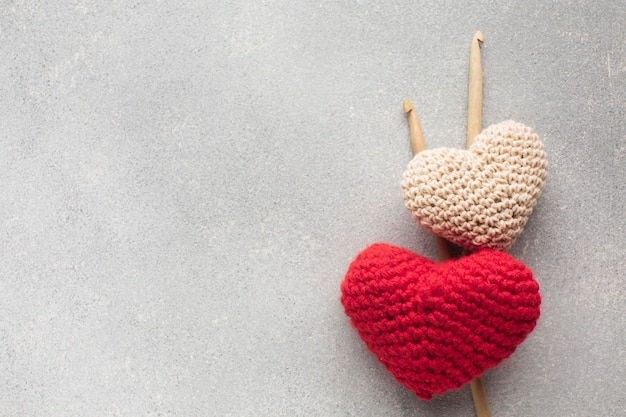 Crocheted heart shapes with copy space background