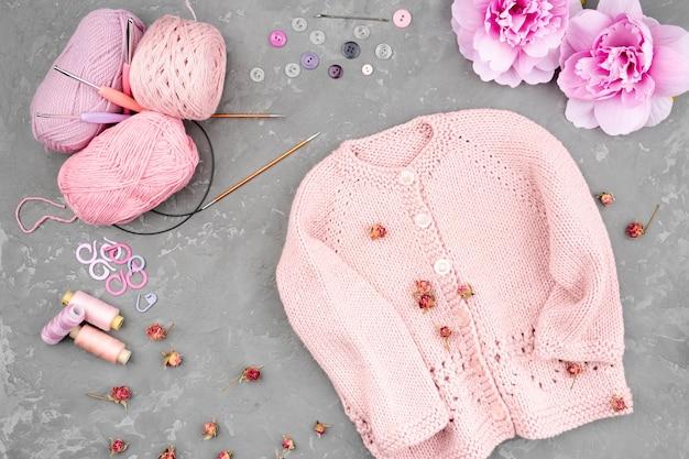 Crocheted jacket on slate background