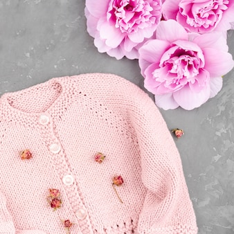 Crocheted pink jacket with flowers