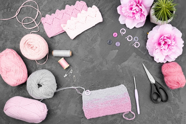 Crocheting supplies on slate background
