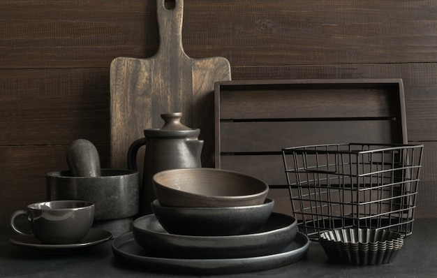 Crockery, clayware, dark utensils and stuff on dark tabletop