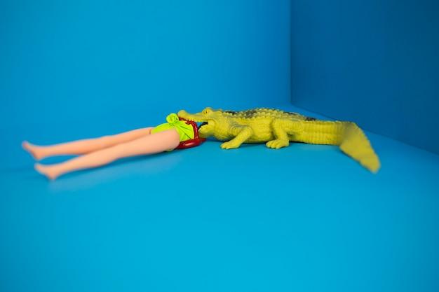 Crocodile and doll