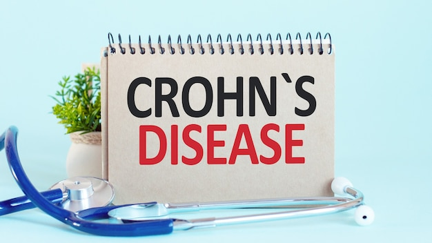 Crohn s disease - diagnosis written on a white piece of paper. treatment and prevention of disease. medical concept. selective focus