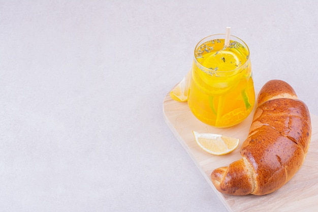 Croissant bun with a glass of lemonade