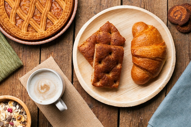 Croissant and cake with cappuccino