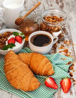 Croissant, coffee, granola  and strawberry
