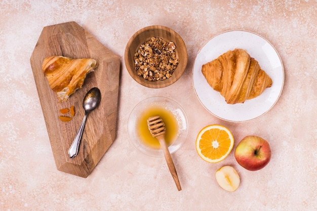 Croissant and fresh fruits top view