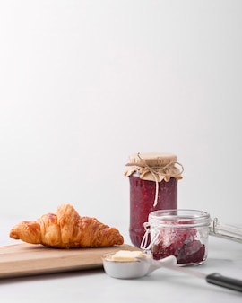 Croissant and homemade wild berry jam