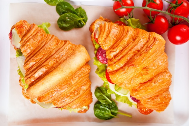 Croissant sandwiches with ham, cheese greens