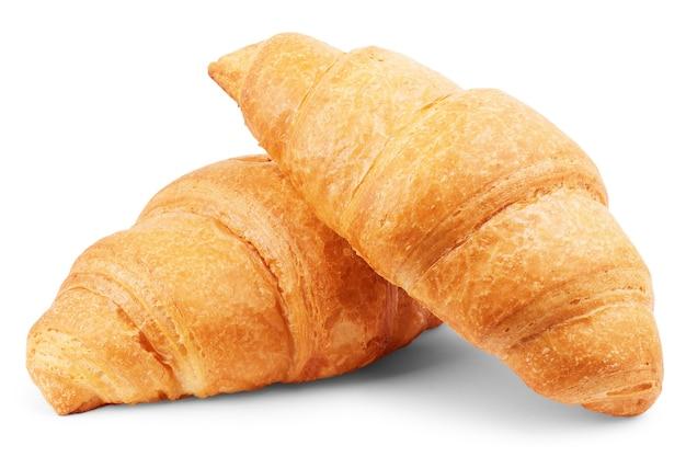 白い背景のクローズアップで分離された粉砂糖を振りかけたクロワッサン