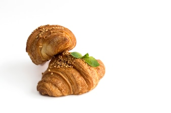 Croissant with almonds on white background