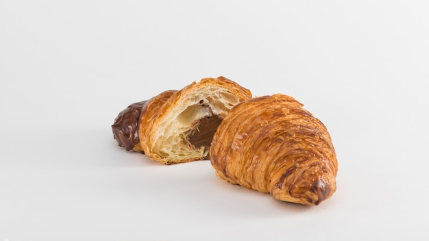 Croissant with chocolate filling isolated on white background