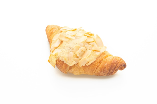 Croissant with cream and almonds isolated on white background