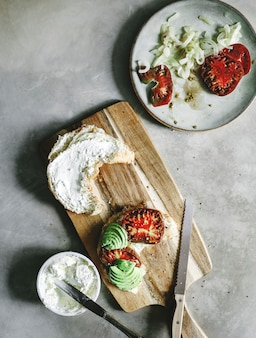 Croissant with heirloom tomato and avocado for breakfast