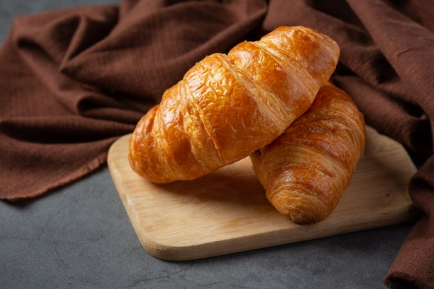 Croissants on black surface.