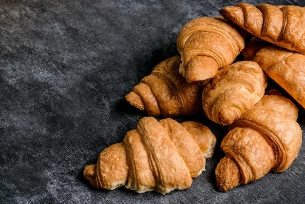 Croissants on grey table.