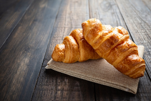 Croissants on old wood table.