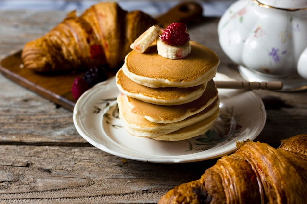 Croissants and pancakes with fruits