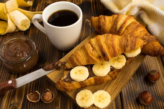 Croissants with chocolate cream and banana