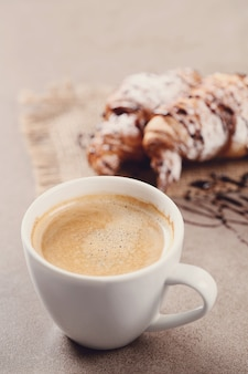 Croissants with coffee cup