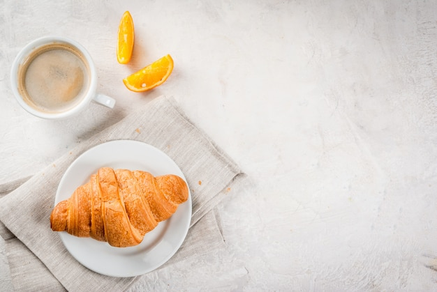 Croissants with coffee and orange