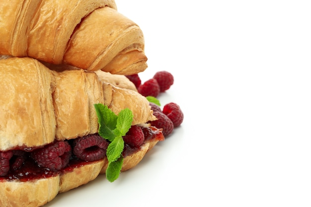Croissants with raspberry jam isolated on white background