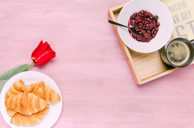 Croissants with tulip and tray with berries