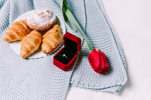 Croissants with wedding ring on scarf