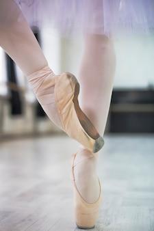 Crop ballerina standing on tiptoes