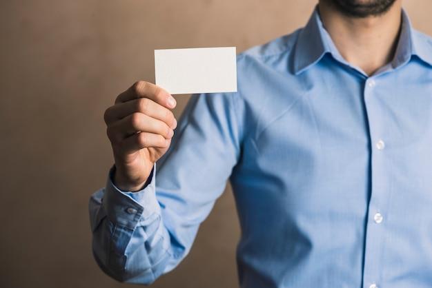 Crop businessman with card