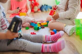 Crop children with toys