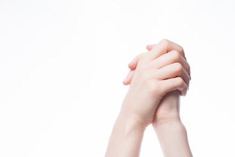Crop clasped hands