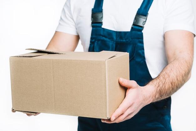 Crop deliveryman holding parcel