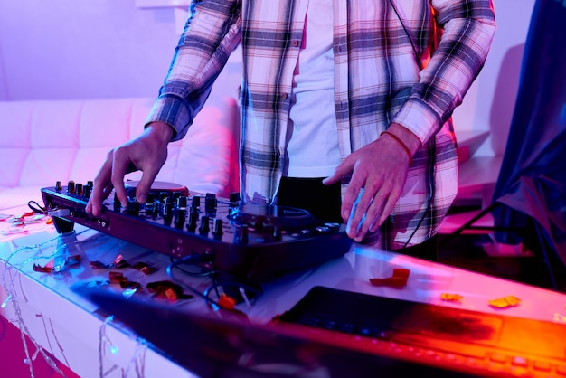 Crop dj with mixer on christmas party