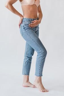 Crop female legs in denim