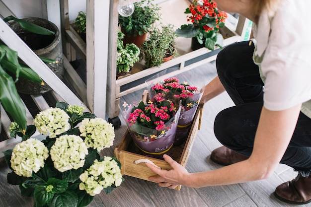 Crop florist lifting box with flowers