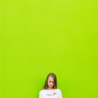 Crop girl on green