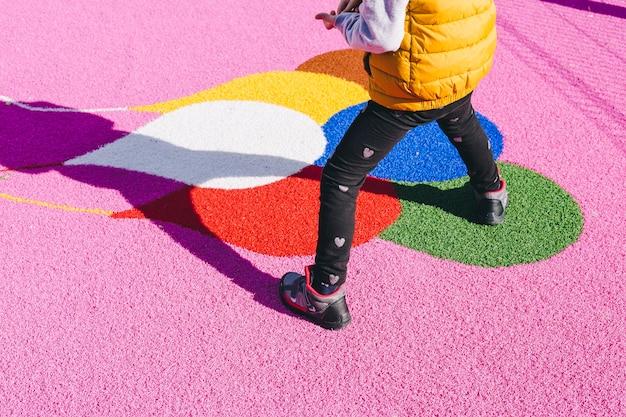 Crop girl on playground