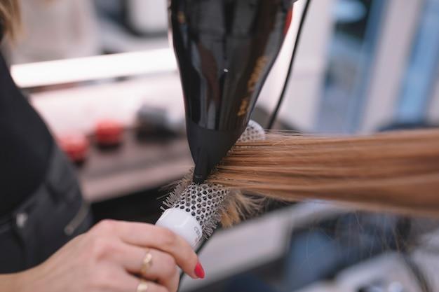Crop hairdresser styling customer
