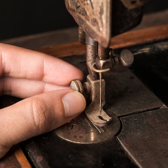 Crop hand adjusting needle on sewing machine
