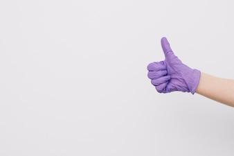 Crop hand gesturing thumb-up