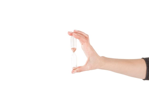 Crop hand holding sandglass
