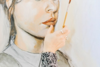 Crop hand painting lips