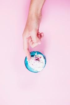 Crop hand touching ice-cream