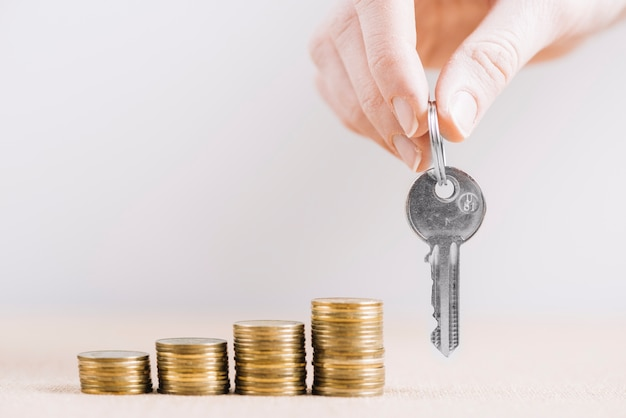 Crop hand with key near money