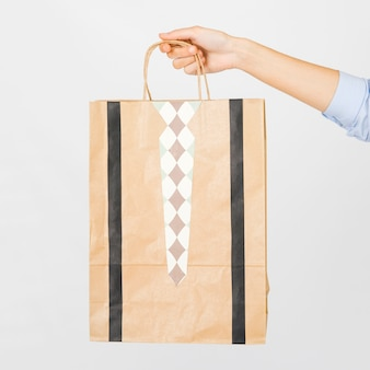 Crop hand with paper bag