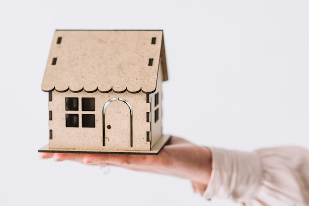 Crop hand with wooden house