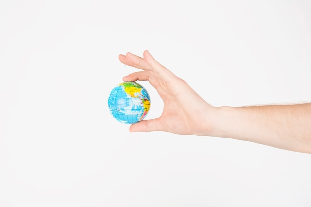 Crop hands holding little globe